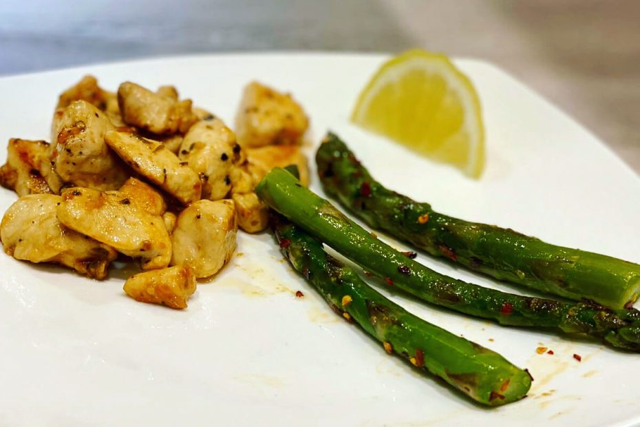 Garlic butter chicken bites with lemon asparagus on the side.