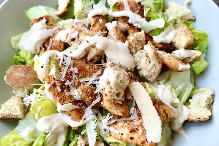 Chicken caesar salad with croutons.
